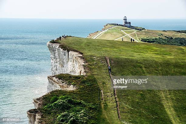chalk cliffs, sea, and belle toute lighthouse - beachy head stock photos and pictures