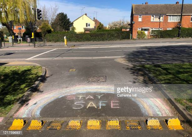 A chalk drawing of a rainbow with the message stay safe on a road on April 08 2020 in Aylesbury England There have been around 50000 reported cases...