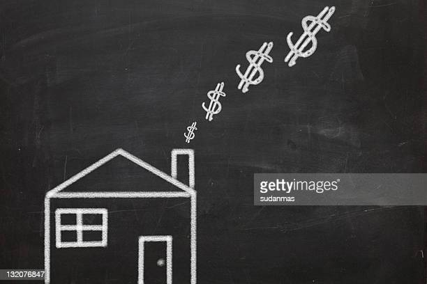Chalk drawing of house burning money