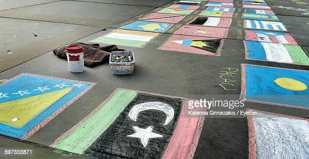chalk drawings of national flags on footpath - chalk art equipment stock pictures, royalty-free photos & images