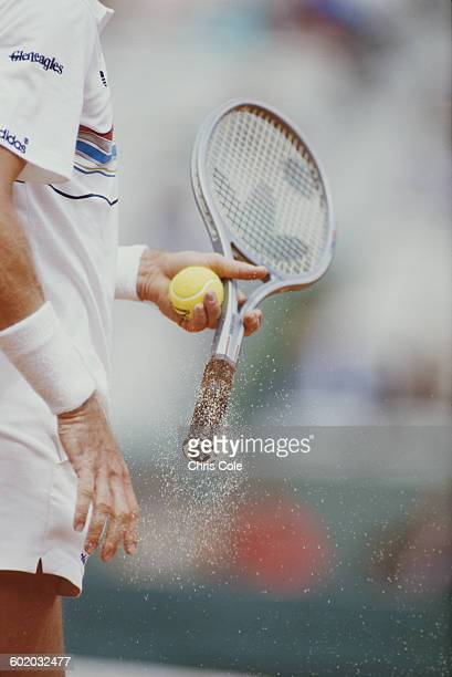 Chalk dust falls from the racquet of Ivan Lendl of Czechoslovakia as he prepares to serve against Mats Wilander during the Men's Singles Final match...