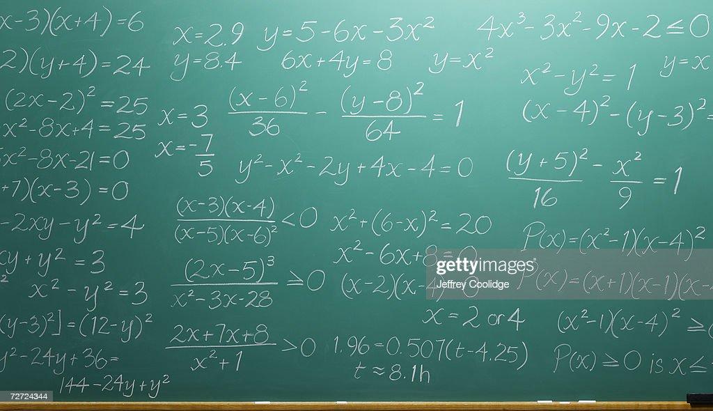 Chalk equations filling blackboard : Stock Photo