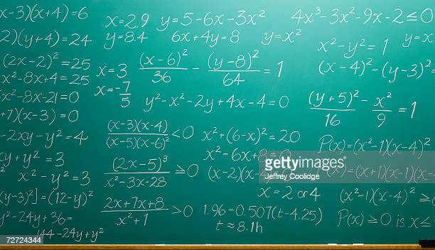 chalk equations filling blackboard - mathematics stock pictures, royalty-free photos & images