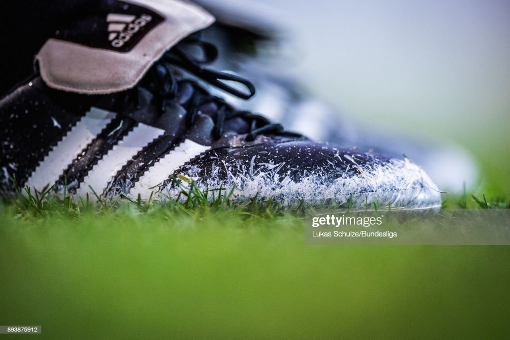 Chalk is seenn on the shoes of the referee during the Bundesliga match between 1. FC Koeln and VfL Wolfsburg at RheinEnergieStadion on December 16, 2017 in Cologne, Germany.