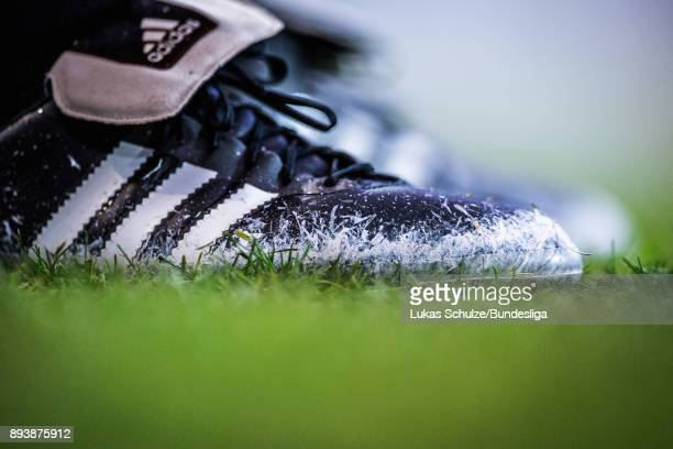 Chalk is seenn on the shoes of the referee during the Bundesliga match between 1 FC Koeln and VfL Wolfsburg at RheinEnergieStadion on December 16...