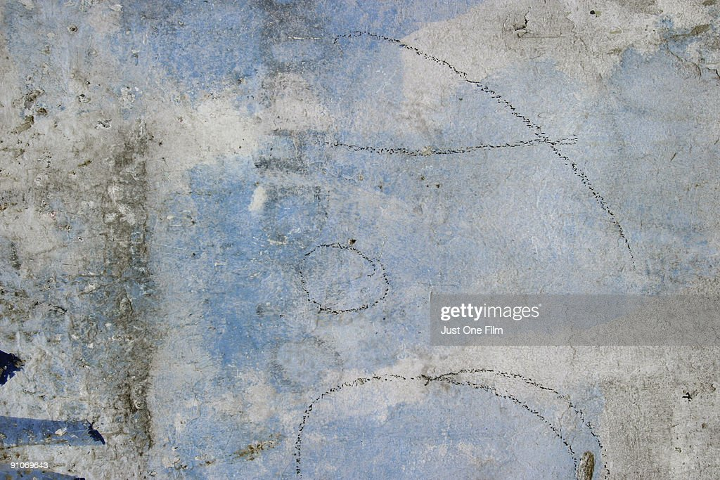 chalk markings on a textured wall stock photo getty images
