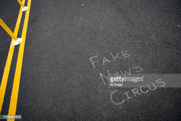 """Chalk message about """"Fake News"""" is written on the street at Black Lives Matter Plaza near the White House, on November 5, 2020 in Washington, DC...."""
