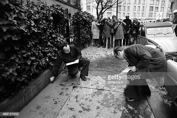 A chalk outline drawn by a police officer shows where French MP and Prince Jean de Broglie was killed on December 24 1976 rue des Dardanelles in...