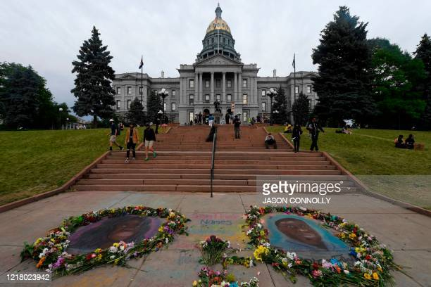 Chalk portraits of Breonna Taylor and George Floyd are seen in front of the Colorado State Capital in Denver Colorado on June 6 during a protest over...