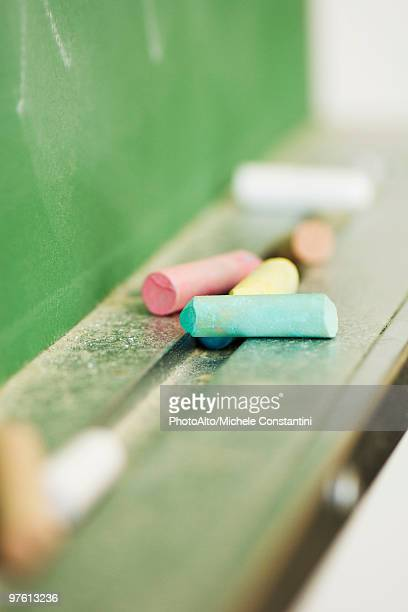 Chalk resting on blackboard, close-up
