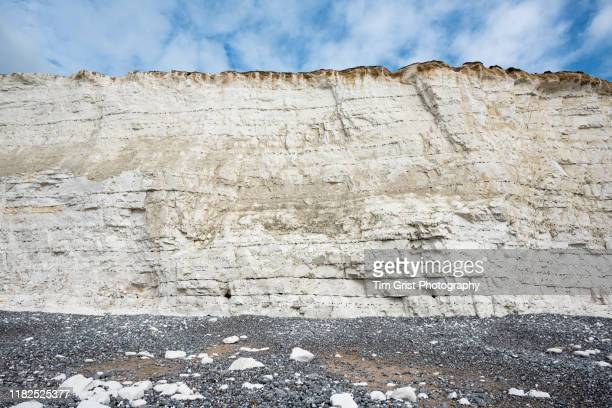 chalk rock face of the seven sisters cliffs, east sussex, uk - chalk rock stock pictures, royalty-free photos & images