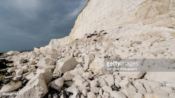 chalk rock fall debris, seven sisters cliffs - chert stock photos and pictures