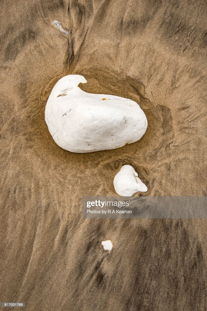 Chalk rocks surrounded by sand patterns : Stock Photo