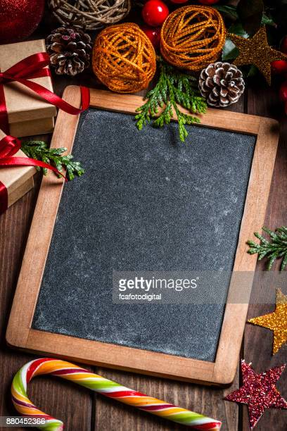chalkboard and christmas decoration - christmas frame stock pictures, royalty-free photos & images