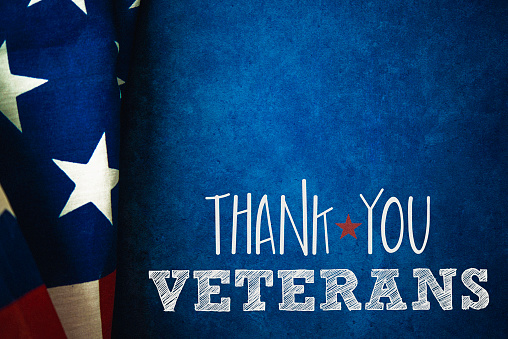 Chalkboard and flag with thank you message for US Veterans 592684210