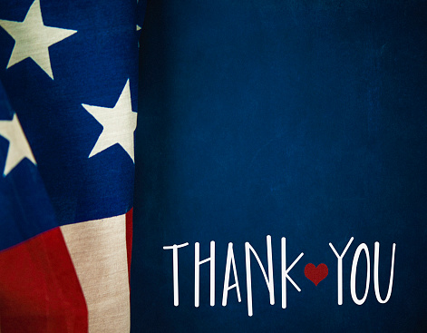Chalkboard and flag with thank you message for US Veterans 598229260