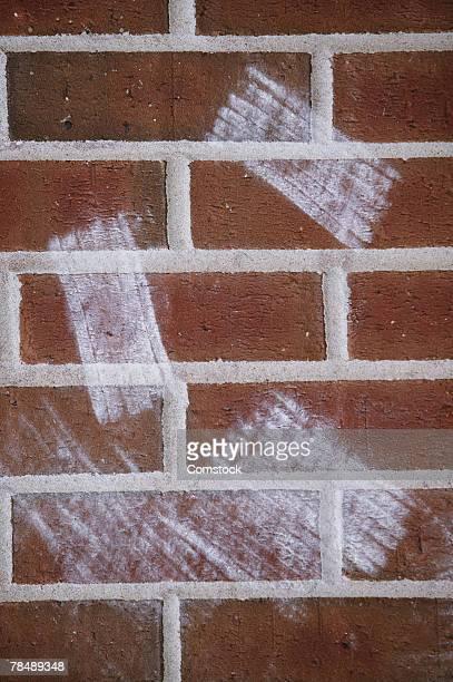 Chalkboard eraser marks on brick wall