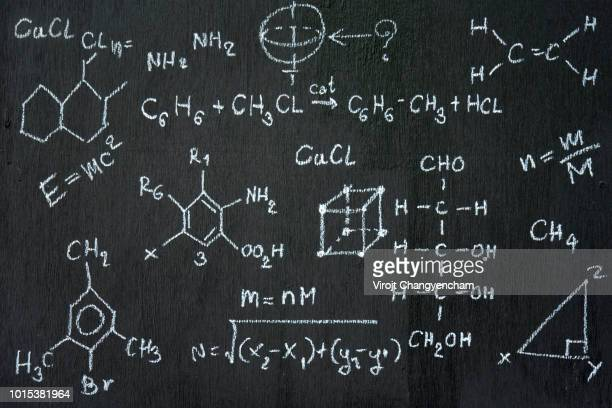 chalkboard inscribed with scientific formulas and calculations in physics and mathematics. vector illustration - physics stock pictures, royalty-free photos & images