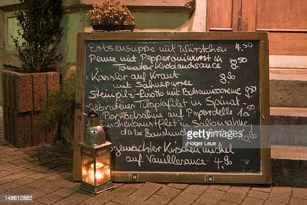 Chalkboard menu outside Eckhaus Restaurant.