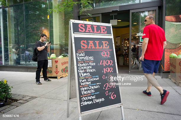 Chalkboard outside of a Whole Foods Market in the New York neighborhood of Tribeca advertises their sales on Thursday, July 31, 2014. Whole Foods is...