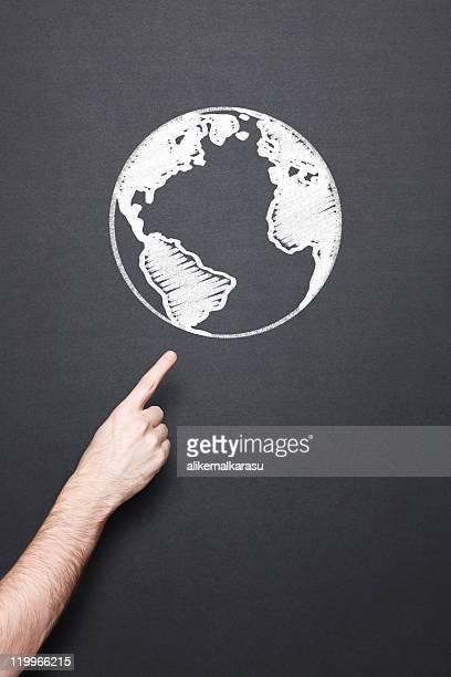 chalkboard with hand and globe