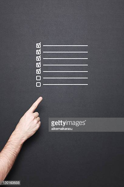 chalkboard with hand and to do list