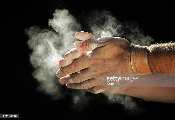 chalking hands - gymnastics stock pictures, royalty-free photos & images