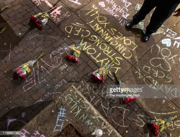 """Chalk-written sentiments and flowers mark the scene of a mass shooting in the city's historic Oregon District where Connor Betts used an """"AR-15-like""""..."""
