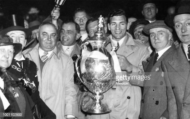 Challenge Cup Final at Wembley Stadium Salford 7 v Barrow 4 Salford captain Gus Risman proudly holds the trophy with manager Lance Todd after they...