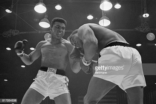 Challenger Cassius Clay punches heavyweight champion Sonny Liston during their 1964 bout. Clay won the title with a TKO of Liston in the 7th round.