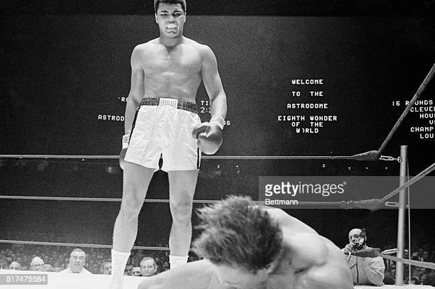Challenger Cleveland Williams hits the canvas in the 3rd round of fight with heavyweight champion Cassius Clay Clay scored 3rd round TKO to retain...