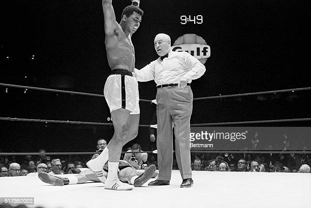 Challenger Cleveland Williams sprawls on the canvas as Muhammad Ali raises his arms in victory Ali retains his heavyweight title by scoring a TKO in...