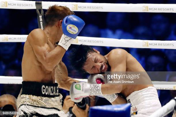 Challenger Cristofer Rosales of Nicaragua connects his left on former champion Daigo Higa of Japan in the 6th round of the WBC Flyweight Title Bout...