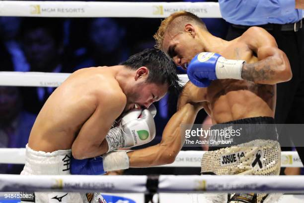 Challenger Cristofer Rosales of Nicaragua connects his right on former champion Daigo Higa of Japan in the 6th round of the WBC Flyweight Title Bout...