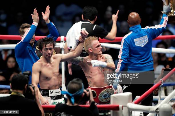 Challenger Hekkie Budler of South Africa greets fans with champion Ryoichi Taguchi of Japan after winning the IBF WBA Light Flyweight Title Bout by a...