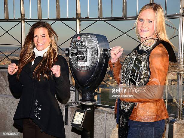 Challenger Miesha Tate and UFC Women's Bantamweight champion Holly Holm visit The Empire State Building at The Empire State Building on January 21...