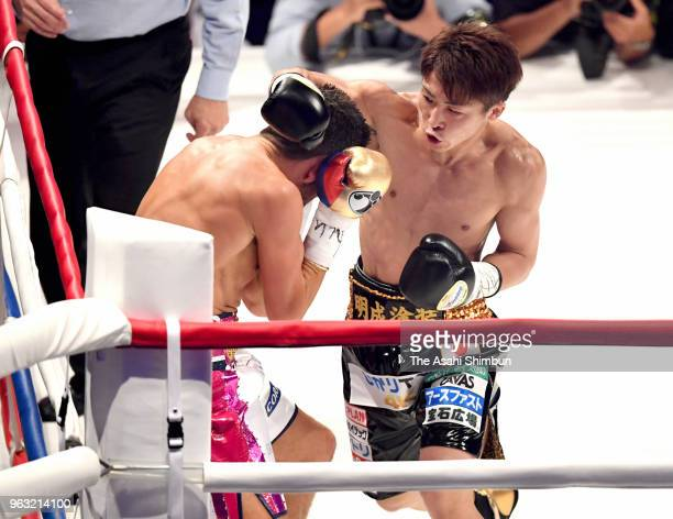 Challenger Naoya Inoue of Japan connects his right on champion Jamie McDonnell of Great Britain in the first round of the WBA Bantamweight Title Bout...