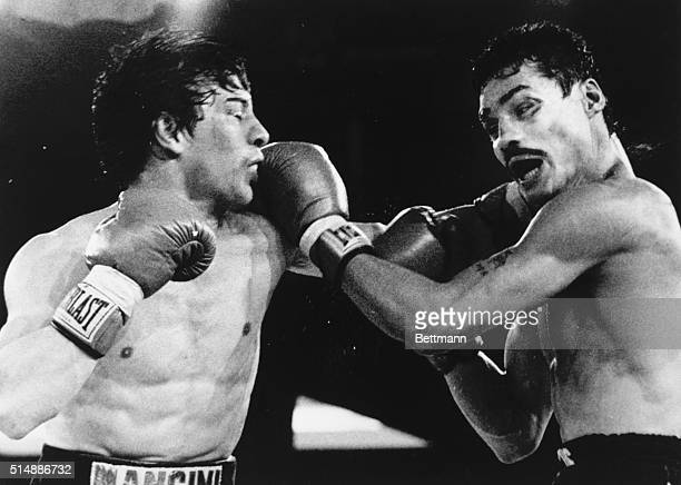 Challenger Ray 'Boom Boom' Mancini of Youngstown Ohio and WBC Lightweight Champion Alexis Arguello exchange blows during the 11th round of their...