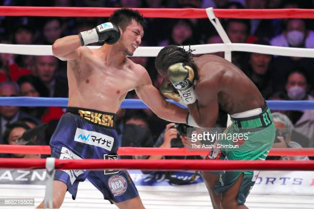 Challenger Ryota Murata of Japan connects his left on champion Hassan N'Dam of France in the 5th round during their WBA Middleweight Title Bout at...