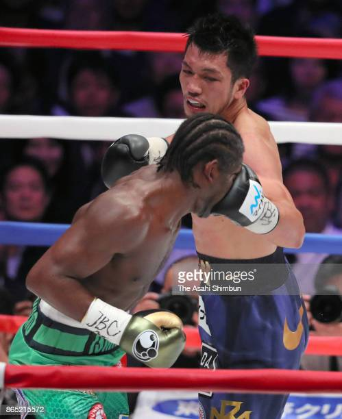 Challenger Ryota Murata of Japan connects his left on champion Hassan N'Dam of France in the 4th round during their WBA Middleweight Title Bout at...