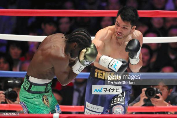 Challenger Ryota Murata of Japan connects his right on champion Hassan N'Dam of France in the 1st round during their WBA Middleweight Title Bout at...