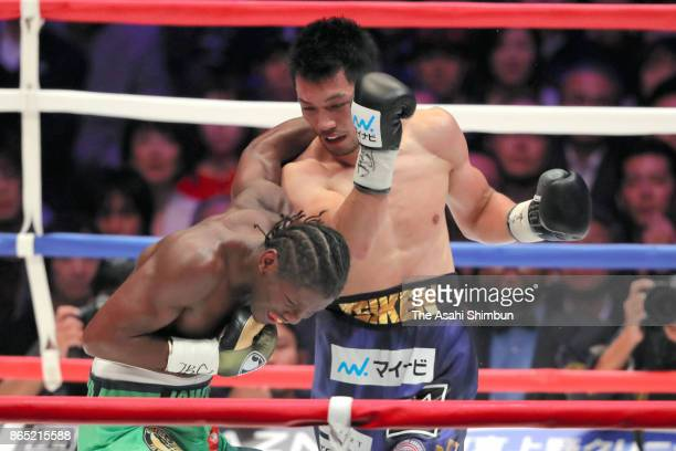 Challenger Ryota Murata of Japan connects his right on champion Hassan N'Dam of France in the 3th round during their WBA Middleweight Title Bout at...