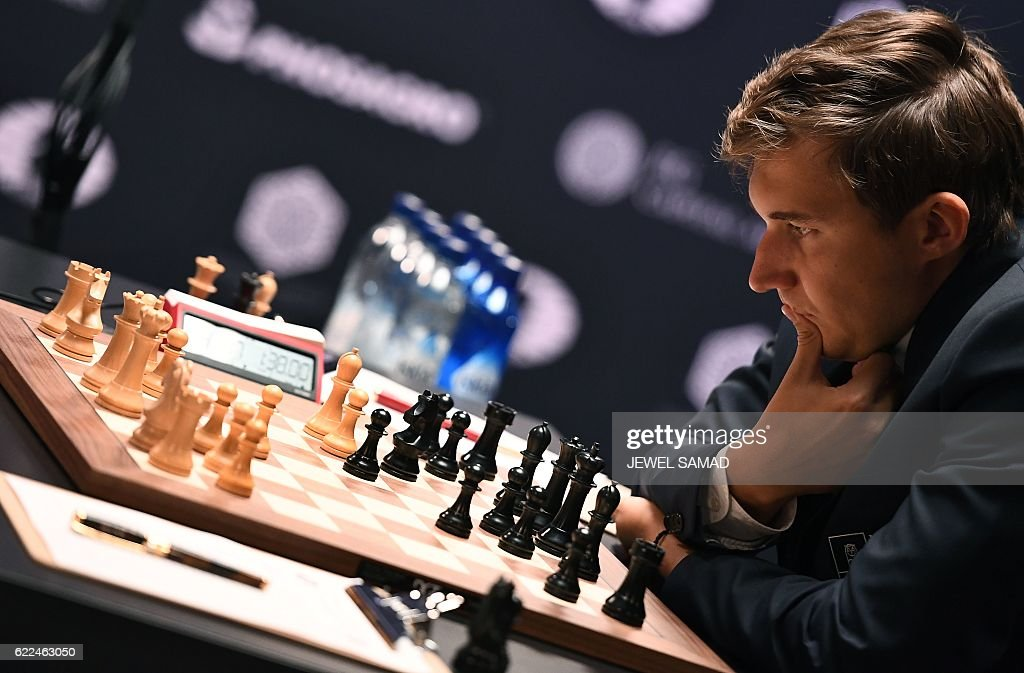 Challenger Sergey Karjakin of Russia concentrates during his World Chess Championship 2016 round 1 match against Chess grandmaster and current world chess champion Magnus Carlsen of Norway, in New York on November 11, 2016. / AFP / Jewel SAMAD