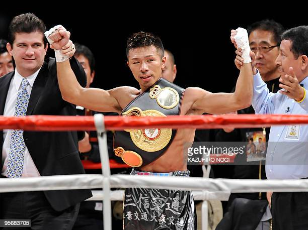 Challenger Takashi Uchiyama of Japan celebrates his victory over champion Juan Carlos Salgado of Mexico during their WBA super featherweight title...