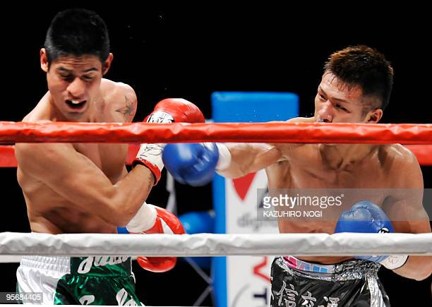 Challenger Takashi Uchiyama of Japan sends a right against champion Juan Carlos Salgado of Mexico in the WBA super featherweight title boxing match...