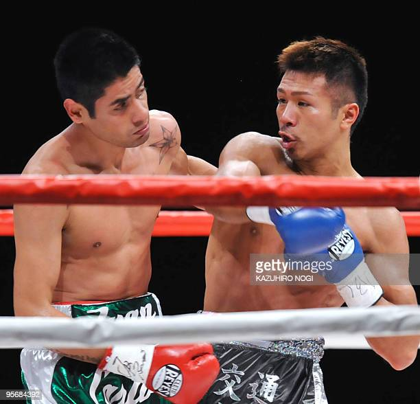 Challenger Takashi Uchiyama of Japan sends his right against champion Juan Carlos Salgado of Mexico in the WBA super featherweight title boxing match...