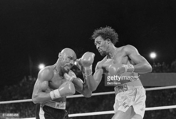 """Challenger Thomas """"Hit Man"""" Hearns strikes middleweight champion """"Marvelous"""" Marvin Hagler with a right to the face during a boxing match in Las..."""