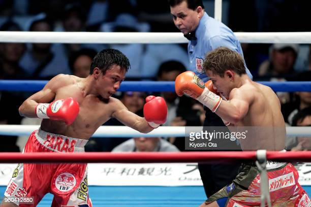Challenger Vince Paras of the Philippines punches champion Hiroto Kyoguchi of Japan during the IBF Minimumweight Title Bout at Ota City General...