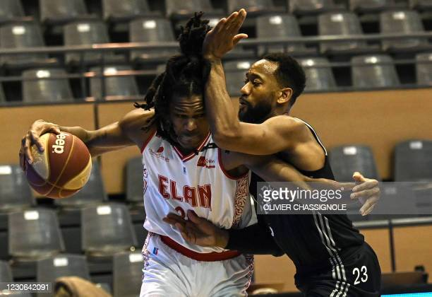 Chalons US player Garrett Sim fights for the ball with ASVEL Lyon-Villeurbanne's US player David Lighty during the French Jeep Elite basketball match...
