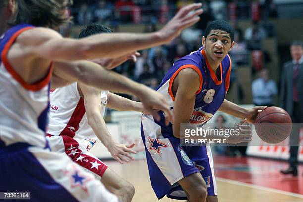 Le Mans' French forward Nicolas Batum vies with Chalon's French guard Philippe Brau during their French Pro A basketball match 18 February 2007 at...